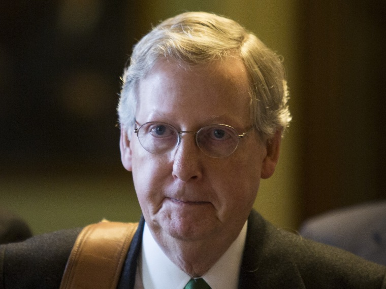 File Photo: Senate Minority Leader Mitch McConnell (R-KY) walks to his office on Capitol Hill December 31, 2012 in Washington, DC. The House and Senate are both still in session on New Year's Eve to try to deal with the looming 'fiscal cliff.' (Photo...