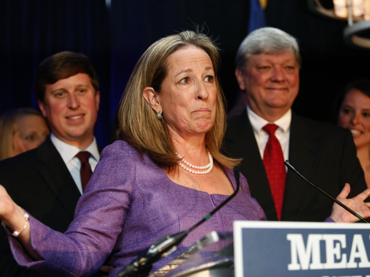 1st Congressional District Democratic candidate Elizabeth Colbert Busch gives her concession speech at the Charleston Renaissance Hotel after losing to Republican Mark Sanford Tuesday, May 7, 2013, in Charleston S.C.  At right is her husband Claus...