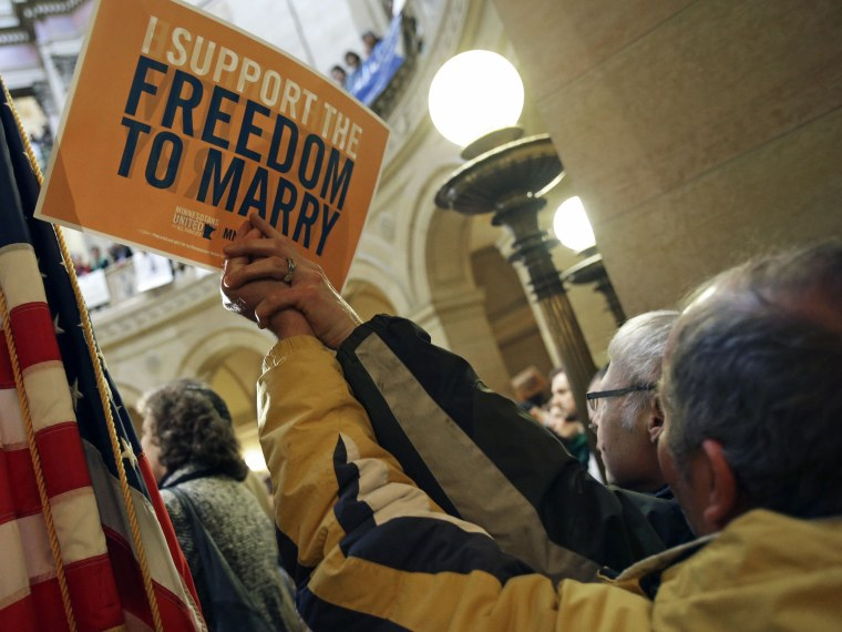 File Photo: In this Feb. 14, 2013 file photo supporters of gay marriage call for Minnesota lawmakers to legalize gay marriage at the State Capitol in St. Paul, Minn. Minnesota has a state House vote on gay marriage  Thursday, May 9, 2013, and...