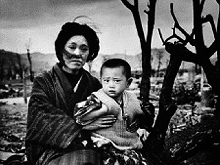A mother and child, dressed in traditional clothing, sit on the ground amid rubble and brunt trees, Hiroshima, Japan, December 1945. On August 6, some four months previously, the United States had dropped an atomic bomb on the city--three days later a...