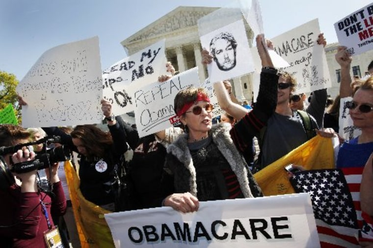 File Photo: Protesters who identified themselves as being with the Tea Party Patriots, including Linda Dorr, of Laguna Beach, Calif., center, demonstrate against the health care law outside of the Supreme Court in Washington, Monday, March 26, 2012. ...