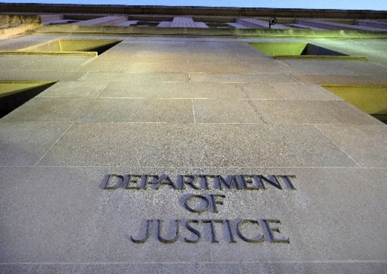 The Department of Justice headquarters building in Washington is photographed early in the morning Tuesday, May 14, 2013. (AP Photo/J. David Ake)