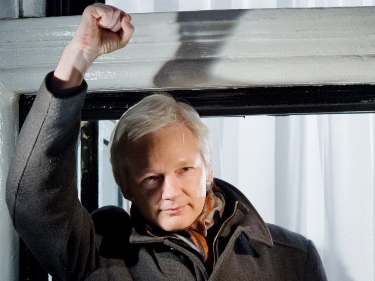 File Photo: Wikileaks founder Julian Assange at the window of the Ecuadorian embassy in Knightsbridge, west London on December 20, 2012. (Photo by Leon Neal/AFP/Getty Images, File)