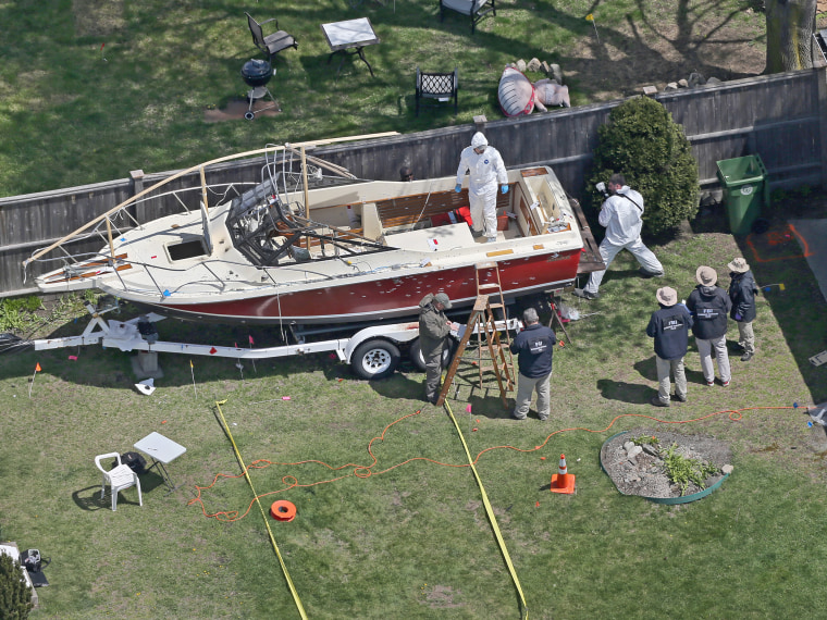 Aerial view of the boat where one of the Boston Marathon bombing suspects was found in Watertown, Mass. (Photo by David L Ryan/The Boston Globe via Getty Images)