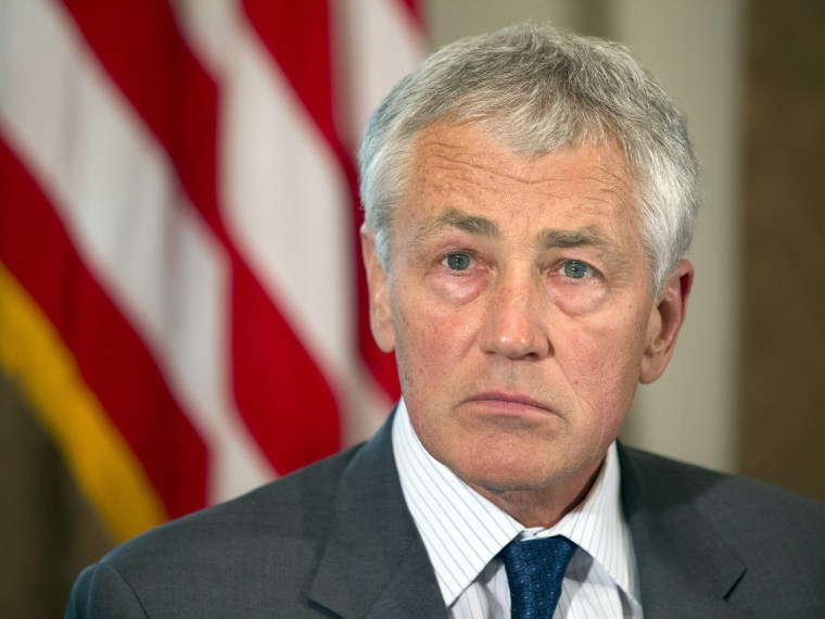 Defense Secretary Chuck Hagel listens as President Barack Obama speaks to media during a meeting with Hagel, Joint Chiefs Chairman Gen. Martin Dempsey, and the service secretaries, service chiefs, and senior enlisted advisers to discuss sexual assault...