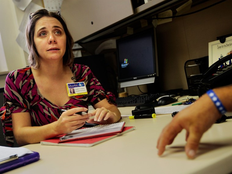 Speech therapist Heather Van Meter (L) of the VA Medical Center looks on as Iraq war veteran suffering from posttraumatic stress disorder (PTSD) Robert Wake describes his difficulties in concentrating and remembering during a counseling session at the...