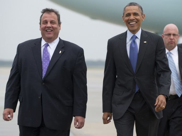 US President Barack Obama walks with New Jersey Governor Chris Christie (L) after arriving at Joint Base McGuire-Dix in New Jersey on May 28, 2013. Obama is traveling to the New Jersey shore to view rebuilding efforts following last year's Hurricane...