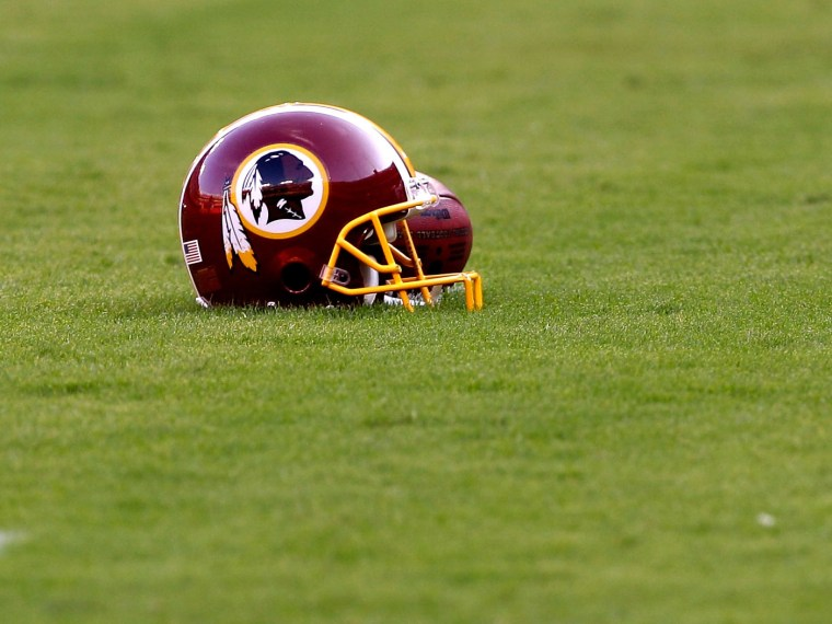 File Photo: A Washington Redskins helmet sits on the field before the start of the preseason game between the Tampa Bay Buccaneers and Redskins at FedExField on September 1, 2011 in Landover, Maryland.  (Photo by Rob Carr/Getty Images, File)