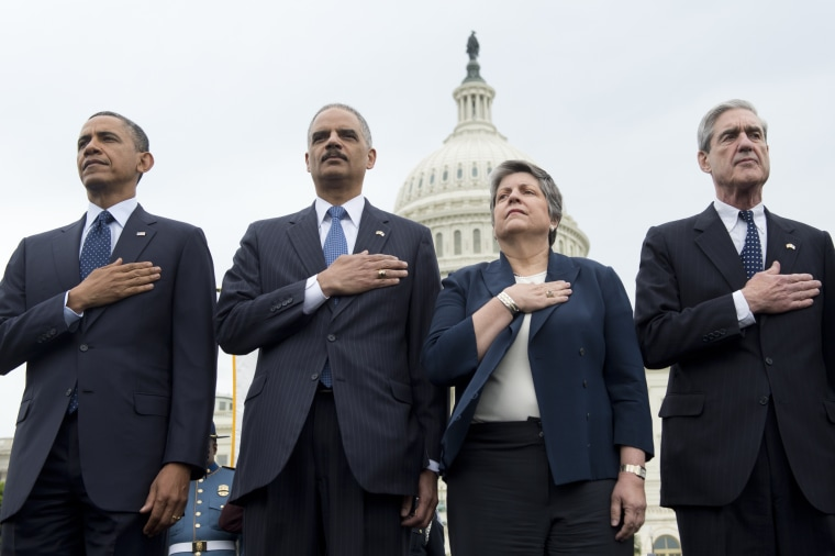 L-R: US President Barack Obama (L), Attorney General Eric Holder, Secretary of Homeland Security Janet Napolitano and Director of the Federal Bureau Investigation (FBI) Robert Mueller stand during the National Anthem at the National Peace Officers...
