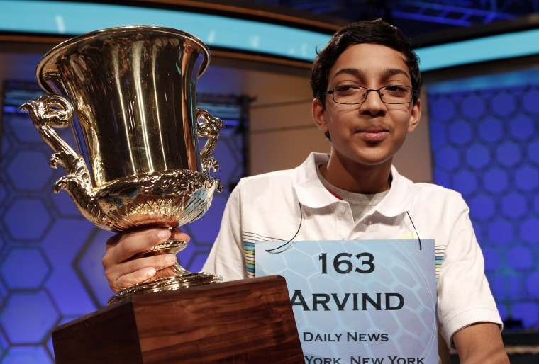 Arvind Mahankali of New York holds his trophy after winning the Scripps National Spelling Bee May 30, 2013. Mahankali, a 13-year-old from Bayside Hills, New York, won the Scripps National Spelling Bee on Thursday. REUTERS/Kevin Lamarque  (UNITED STATES
