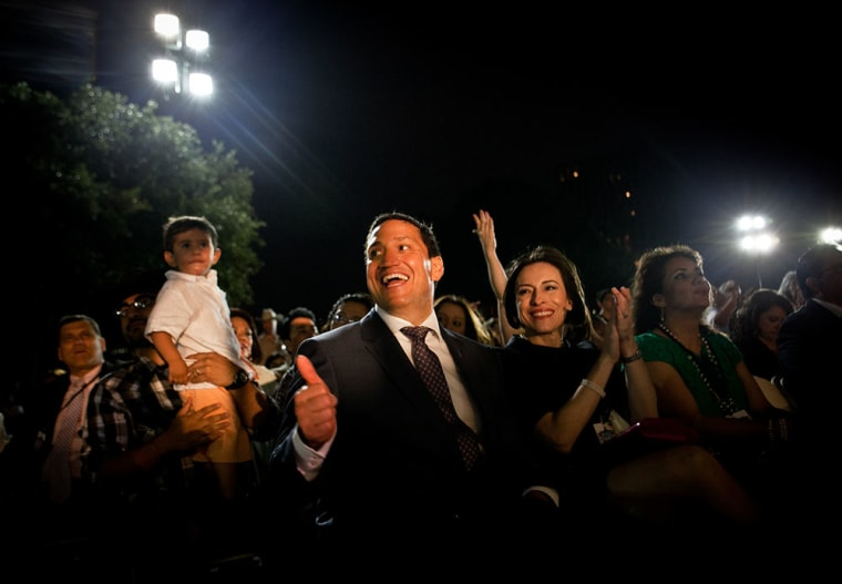 Rep. Trey Martinez Fischer (TX) claps and cheers next to his wife, Elizabeth Provencio, Right (short black hair) at the Mexican American Legislative Caucus's 40th Anniversary, which drew a crowd of thousands with dancing and music by the famous Latino...