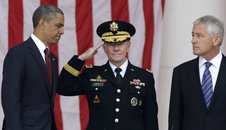 U.S. President Barack Obama (L-R) is greeted by Chairman of the Joint Chiefs of Staff U.S. Army General Martin Dempsey and U.S. Defense Secretary Chuck Hagel as he takes the stage for remarks at the Memorial Day observances at Arlington National...