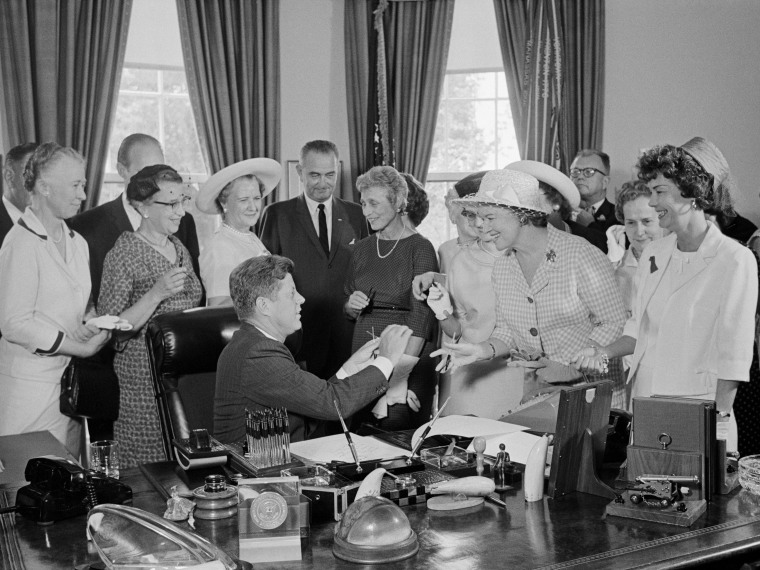 President Kennedy is seen during a ceremony at the White House in which he signed into law a bill aimed at assuring women of paychecks equal to those of men doing the same work on June 10, 1963 in Washington, DC. (Photo by Bettmann/Corbis)