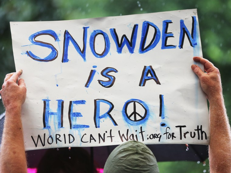 File photo: A supporter holds a sign at a small rally in support of National Security Administration (NSA) whistle-blower Edward Snowden June 10, 2013 in New York City.  (Photo by Mario Tama/Getty Images)