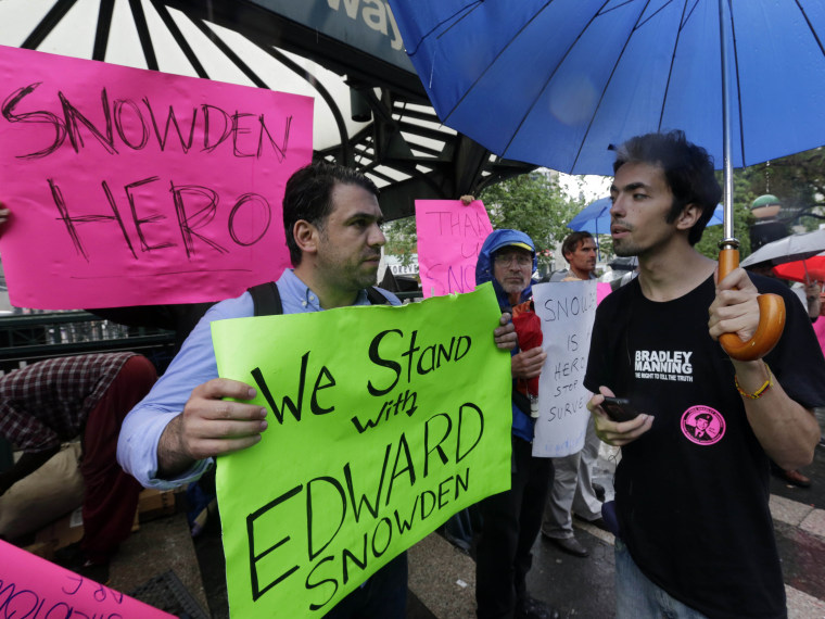 Demonstrators hold signs supporting Edward Snowden in New York's Union Square Park, Monday, June 10, 2013. Snowden, who says he worked as a contractor at the National Security Agency and the CIA, gave classified documents to reporters, making public...