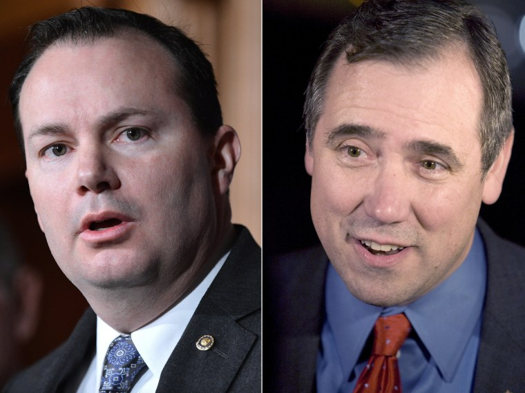 """This digital composite shows file photos: (L): Senator Mike Lee, R-UT, speaks during a press conference on defunding """"Obamacare"""" March 13, 2013. (Photo by Jewel Samad/AFP/Getty Images) (R): Democratic Senator Jeff Merkley from Portland, Ore., on..."""