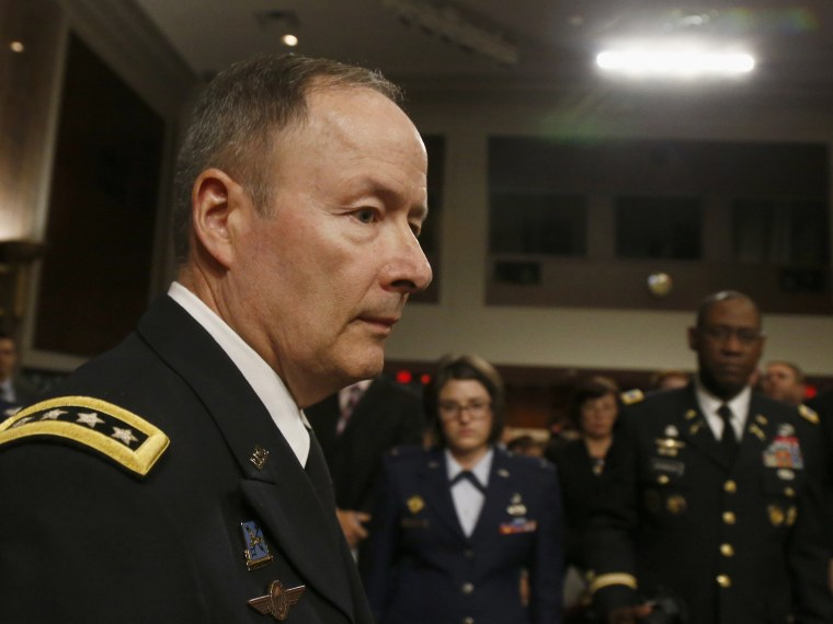 Gen. Keith B. Alexander, commander, U.S. Cyber Command and director, National Security Agency/Chief, Central Security Service arrives  on Capitol Hill in Washington, Wednesday, June 12, 2013, to testify before the Senate Appropriations Committee...