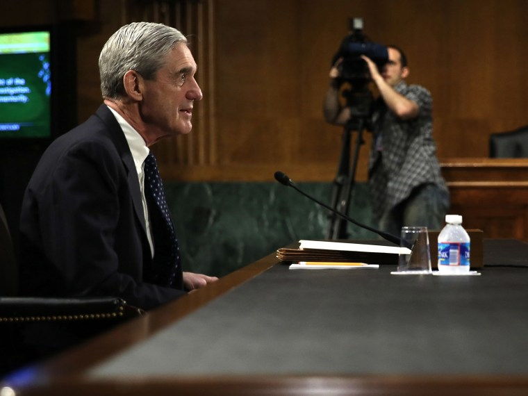 """FBI Director Robert Mueller testifies during a hearing before the Senate Judiciary Committee June 19, 2013 on Capitol Hill in Washington, DC. The committee held a hearing on """"Oversight of the Federal Bureau of Investigation.""""  (Photo by Alex Wong/Getty..."""