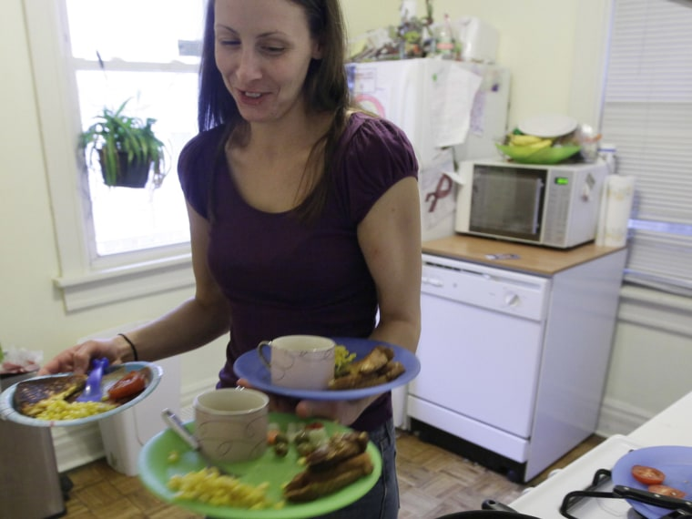 File Photo: Lisa Zilligen, 28, serves lunch for her three children at her home in Chicago, Nov. 23, 2009. Zilligen, a single mother and full time student at Loyola University has been getting food stamps for the past several months; sometimes the...