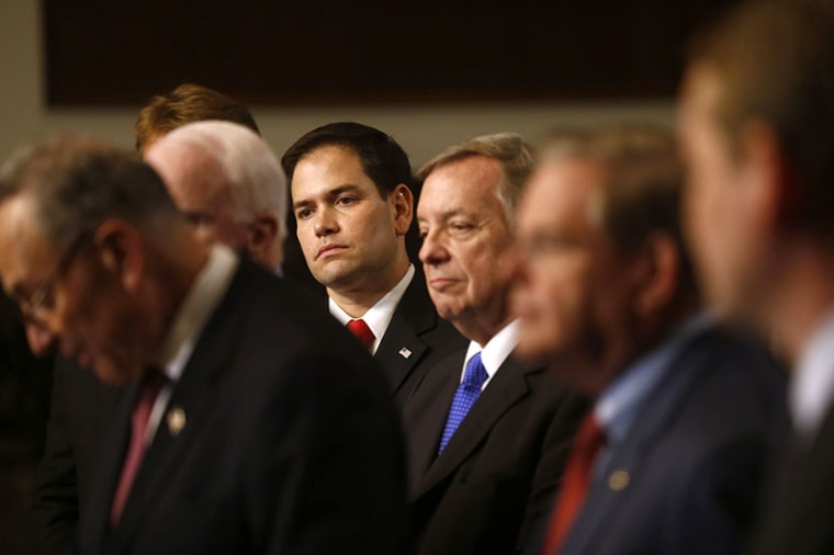 Sen. Marco Rubio, R-Fla., center, and others Senators, participate in a news conference on immigration,  April 18, 2013, on Capitol Hill in Washington. (Photo by Charles Dharapak/AP)