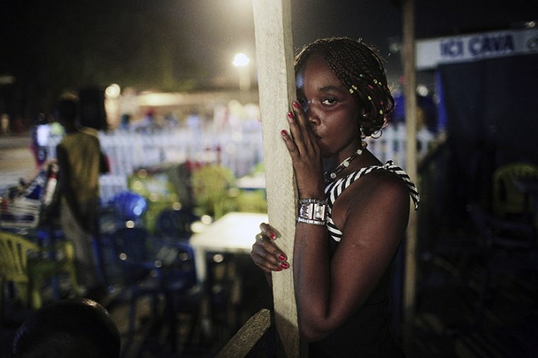 An unidentified sex worker looks for customers at bar late at night in the Bon Marche district in central Kinshasa, Congo, DRC. (Photo by Per-Anders Pettersson/Getty Images)