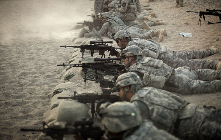 U.S. soldiers from the 5th. Striker Brigades training session at a military base in Kandahar, Afghanistan. (Photo by Emilio Morenatti/AP)