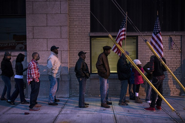 Voters wait in front of the Mt. Pleasant Library November 6, 2012 in Cleveland, Ohio. (Photo by Brendan Smialowski/AFP/Getty Images)