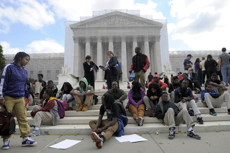 People supporting the University of Texas rally outside the Supreme Court in Washington, Wednesday, Oct. 10, 2012. The Supreme Court is taking up a challenge to a University of Texas program that considers race in some college admissions. The case...