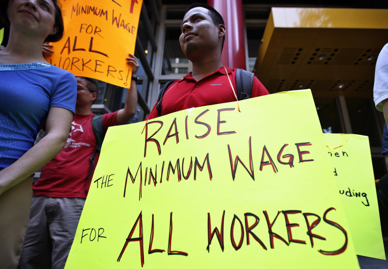 Low wage workers take part in a protest organized by the Coalition for a Real Minimum Wage outside the offices of New York Governor Andrew Cuomo, May 30, 2013. (REUTERS/Mike Segar)