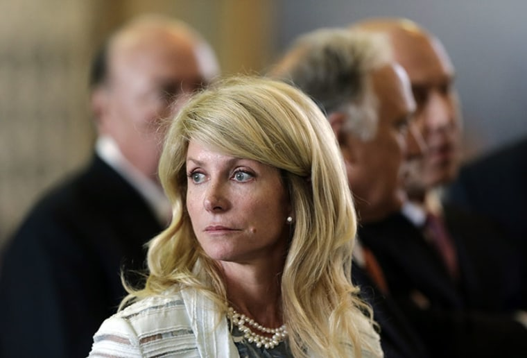 Sen. Wendy Davis, D-Fort Worth, waits for a ruling on a rules violation during her filibusters of an abortion bill, Tuesday, June 25, 2013, in Austin, Texas. (Photo by Eric Gay/AP)