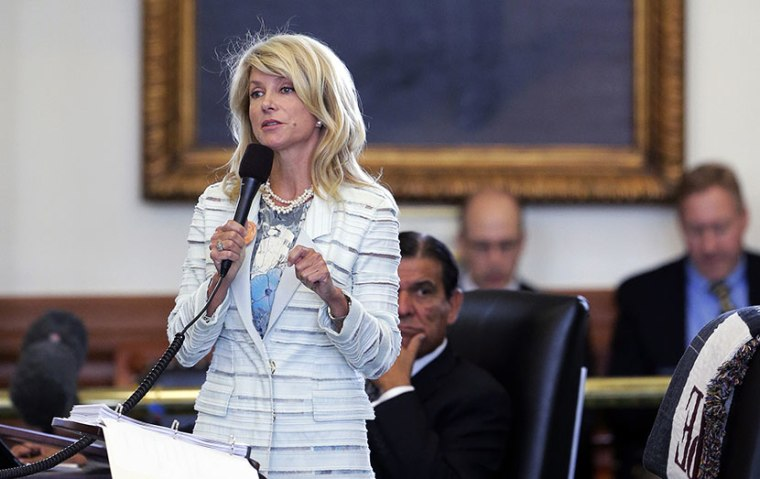 Standing in front of a portrait of President Lyndon B. Johnson, Sen. Wendy Davis, D-Fort Worth, begins a filibuster in an effort to kill an abortion bill, Tuesday, June 25, 2013, in Austin, Texas. The bill would ban abortion after 20 weeks of pregnancy...