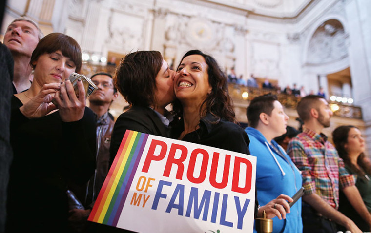 A couple celebrates upon hearing the U.S. Supreme Court's rulings on gay marriage in San Francisco on June 26, 2013.  (Photo by Justin Sullivan/Getty Images)