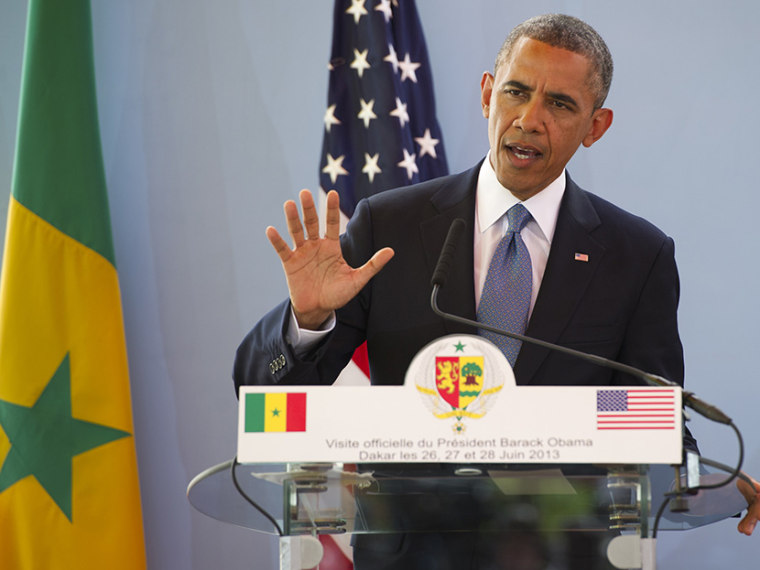 US President Barack Obama speaks during a press conference with Senegal's President following meetings at the Presidential Palace in Dakar, June 27, 2013. (Photo by Saul Loeb/AFP/Getty Images)