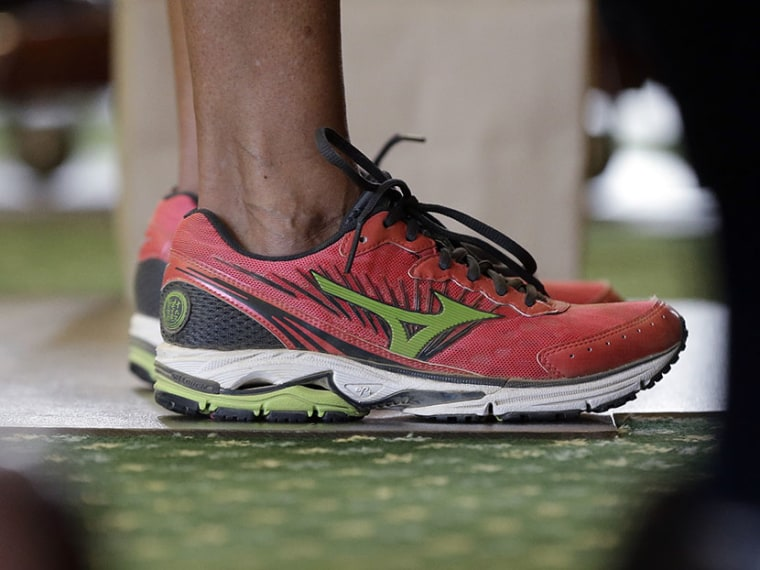 Sen. Wendy Davis, D-Fort Worth, wears tennis shoes in place of her dress shoes as she begins a one-woman filibuster in an effort to kill an abortion bill, Tuesday, June 25, 2013, in Austin, Texas. (Photo by Eric Gay/AP)