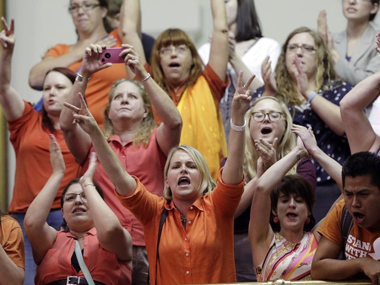 In this June 26, 2013 file photo, members of the gallery cheer and chant as the Texas Senate tries to bring an abortion bill to a vote as time expires, in Austin, Texas. (Photo by Eric Gay/AP)