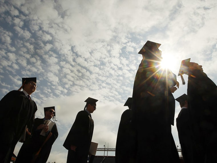 Graduating students arrive for Commencement Exercises at Boston College in Boston, Massachusetts May 20, 2013.  (Photo by Brian Snyder/Reuters)
