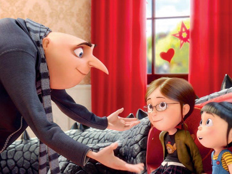 (L - R) Gru (STEVE CARELL) talks with Margo (MIRANDA COSGROVE) and Agnes (ELSIE FISHER) (Courtesy of Universal Pictures)
