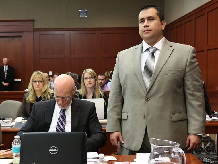 George Zimmerman with defense counsel Don West, listens to judge Debra Nelson as she questions him on his understanding of the proceedings, in Seminole circuit court, July 9, 2013 in Sanford, Florida. (Photo by Joe Burbank/Pool/Getty Images)