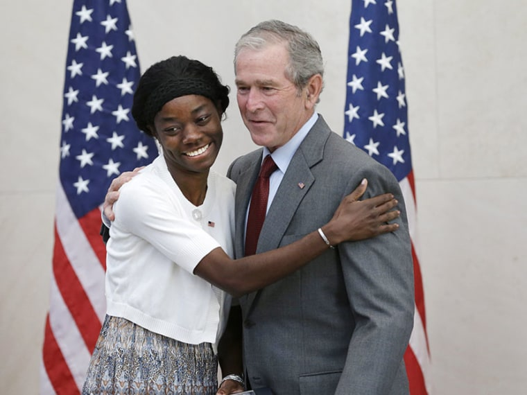 Former President George W. Bush, right, posses for a photo with Mondell Bernadette Avril after she was sworn in as a U.S. citizen during a ceremony at the The George W. Bush Presidential Center in Dallas, Wednesday, July 10, 2013.  (Photo by LM Otero/AP)