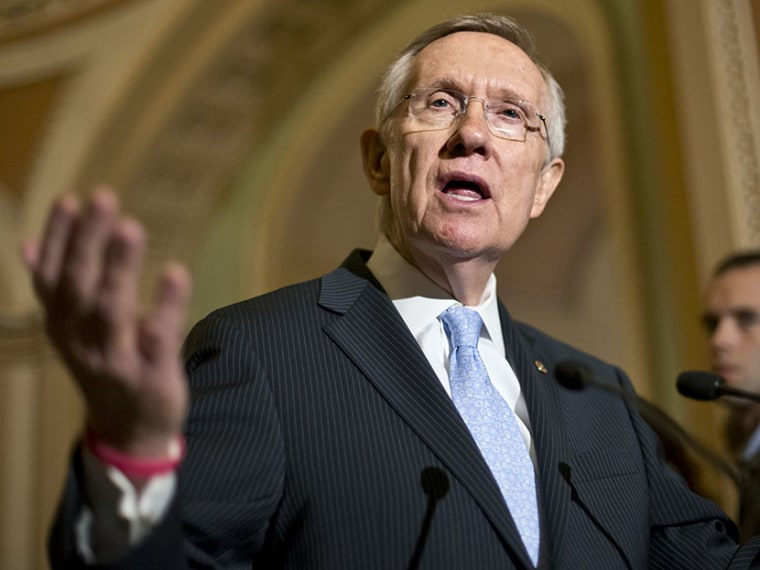 Senate Majority Leader Harry Reid of Nev. gestures as he speaks with reporters on Capitol in Washington, Tuesday, July 9, 2013 (Photo by J. Scott Applewhite/AP)
