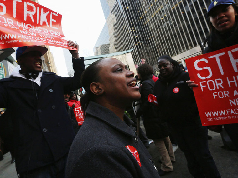 Fast food workers and supporters protest for better wages outside a Wendy's restaurant in Manhattan on April 4, 2013 in New York City. (Photo by Mario Tama/Getty Images)