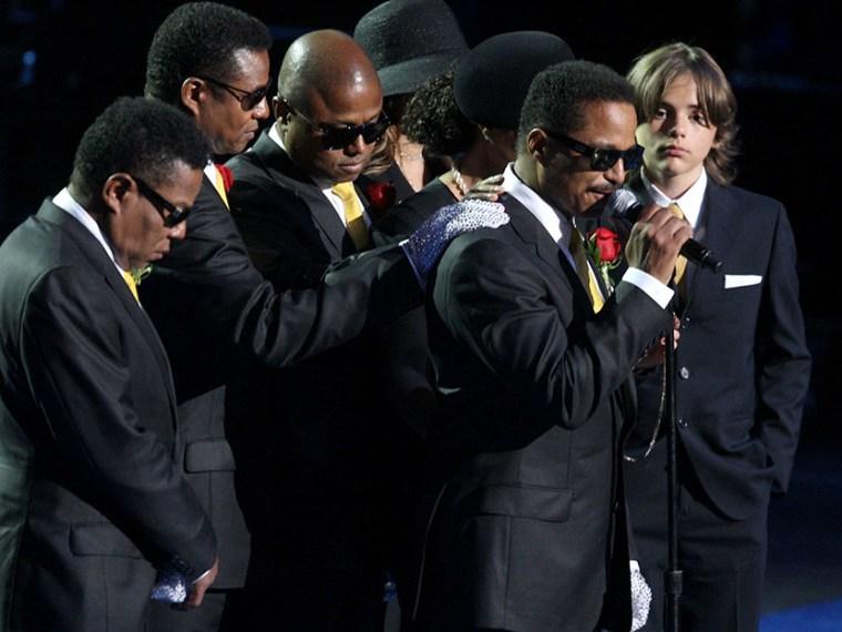 (L-R) Tito Jackson, Jermaine Jackson, Randy Jackson, La Toya Jackson, Janet Jackson and Michael Jackson's son Prince Michael Jackson look on as Marlon Jackson (2nd R) speaks during the Michael Jackson public memorial service held at Staples Center on...