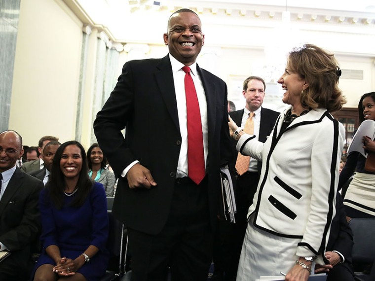 Charlotte Mayor Anthony Foxx shares a moment with U.S. Sen. Kay Hagan (D-NC) after Hagan introduced Foxx during his confirmation hearing before the Senate Commerce, Science and Transportation Committee May 22, 2013 on Capitol Hill in Washington, DC.  ...