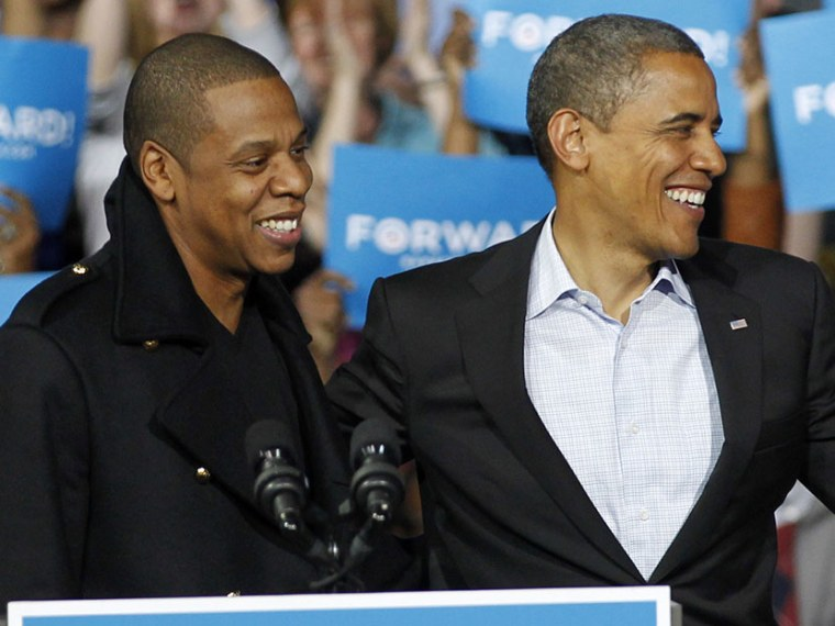 Jay-Z and President Barack Obama smile during a campaign event at Nationwide Arena Monday, Nov. 5, 2012, in Columbus, Ohio. (Photo by Tony Dejak/AP)