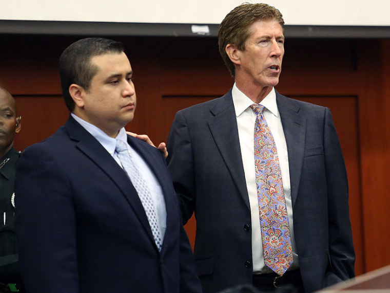 George Zimmerman, left,  stands in the courtroom with defense counsel Mark O'Mara during closing arguments in his trial at the Seminole County Criminal Justice Center, in Sanford, Fla., Friday, July 12, 2013. Photo by Orlando Sentinel/Joe Burbank/Pool/AP