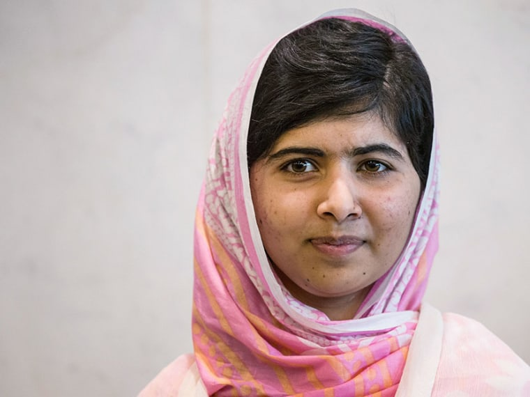 Malala Yousafzai, the 16-year-old Pakistani advocate for girls education who was shot in the head by the Taliban, pauses for a media photo opportunity while attending the United Nations Youth Assembly on July 12, 2013 in New York City. (Photo by Andrew...