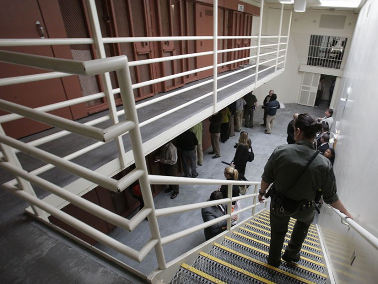 Reporters inspect one of the two-tiered cell pods in the Secure Housing Unit at the Pelican Bay State Prison near Crescent City, Calif., Wednesday, Aug. 17, 2011.  (Photo by Rich Pedroncelli/AP)