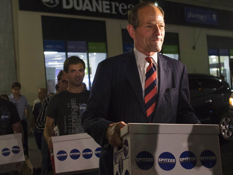 Former New York Governor Eliot Spitzer (front) delivers signatures to the board of elections office in New York July 11, 2013. Spitzer, who is attempting a political comeback five years after resigning from office in a prostitution scandal, is leading...