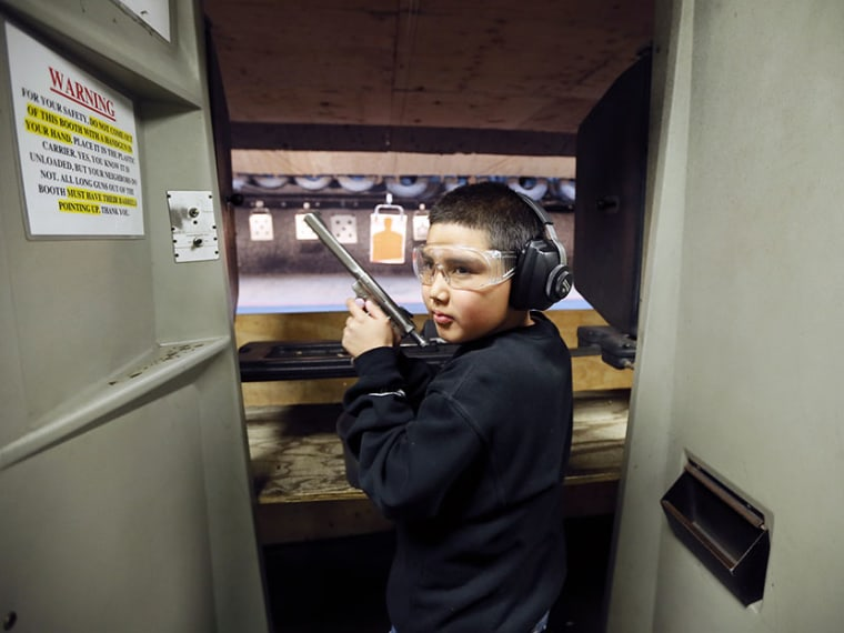Andrew Josequera, 11, prepares to shoot at a target at the Los Angeles gun club in Los Angeles, January 23, 2013.  (Photo by Lucy Nicholson/Reuters)