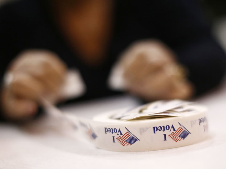 A poll worker prepares 'I Voted' stickers at Harrison United Methodist Church during the U.S. presidential election in Pineville, North Carolina November 6, 2012. (Photo by Chris Keane/Reuters)
